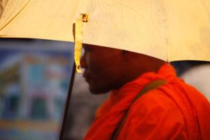 monk under umbrella